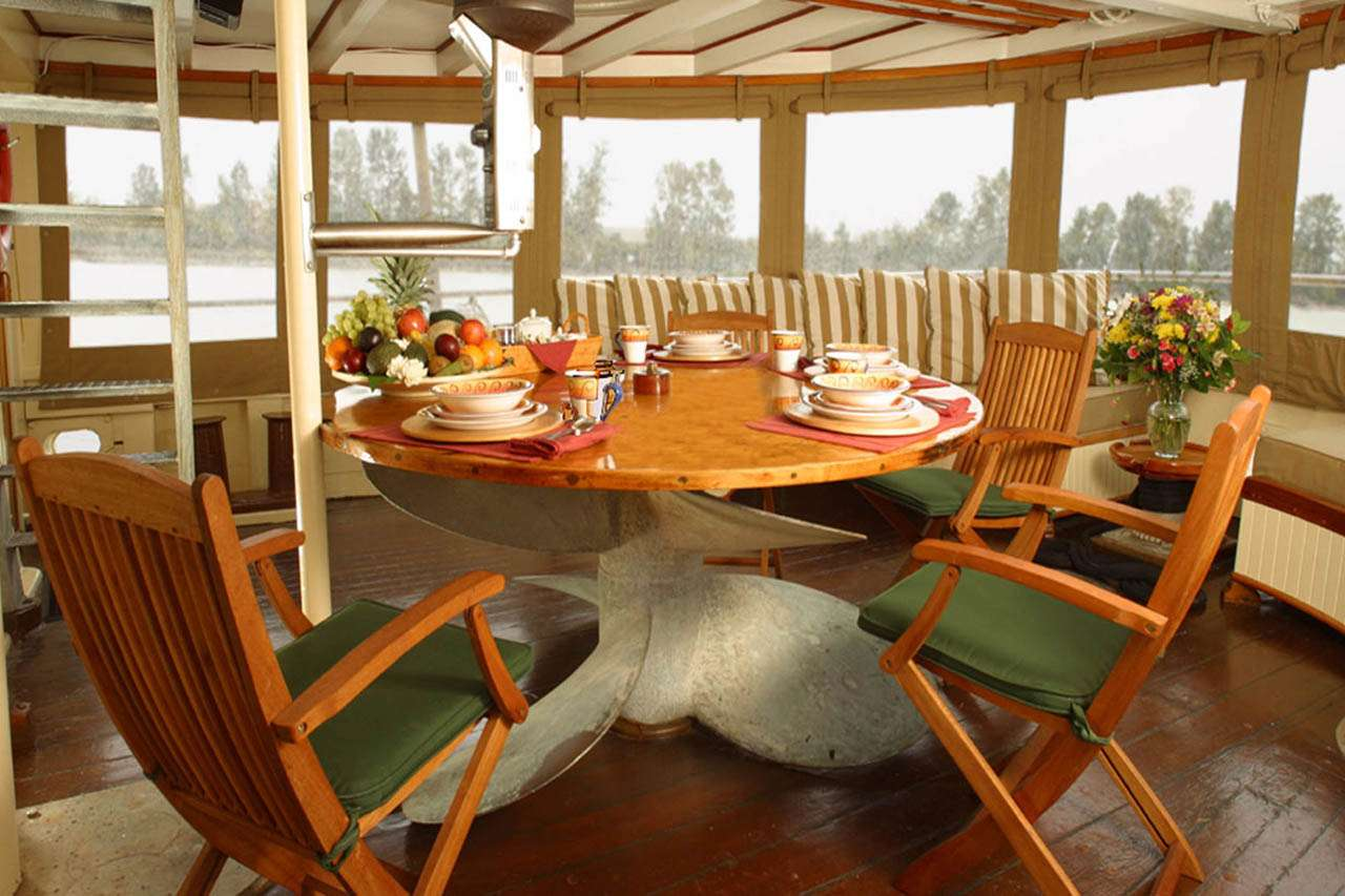 Aft Deck Dining for 8.  This area can be fully enclosed.