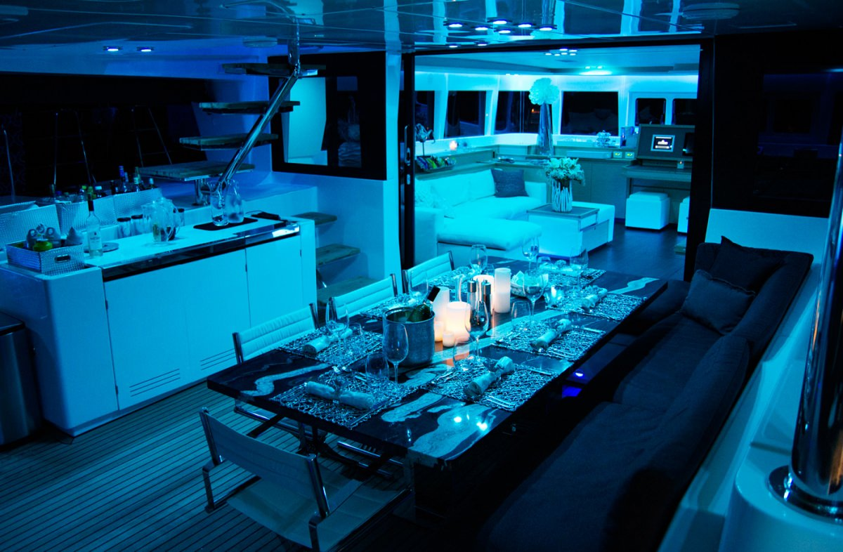 Aft deck alfresco dining with mood lighting