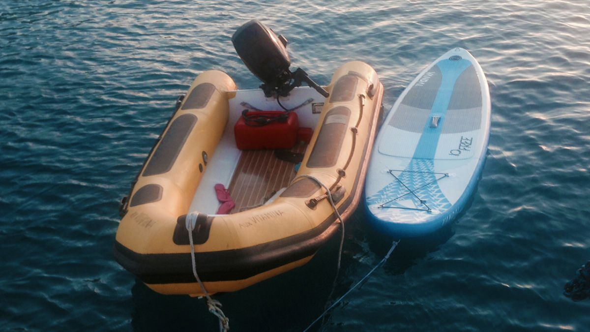 The tender and stand-up paddle board