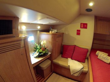 Starboard aft suite with queen-sized bed, spacious sette, and vanity.