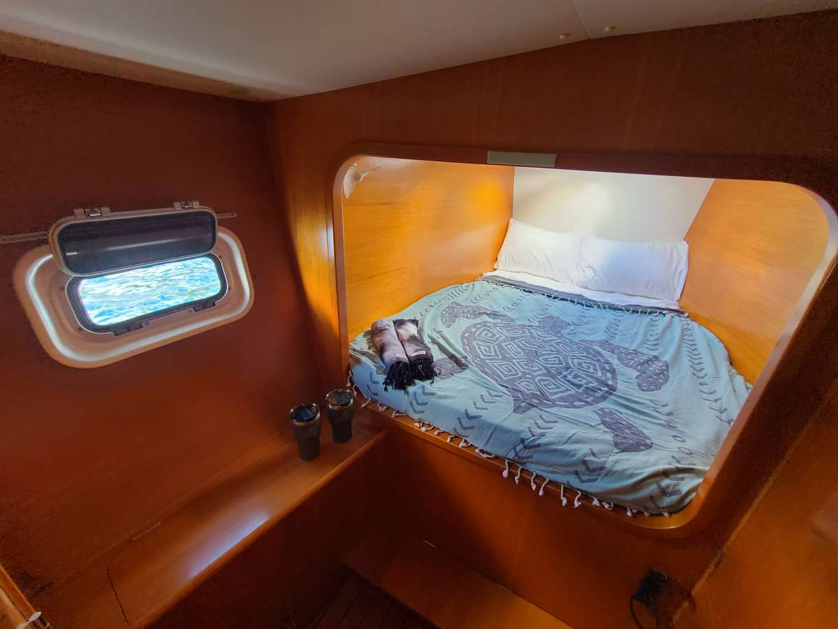 Port forward Stateroom Queen Bed.  All rooms have 2 fans and a hatch to catch natural ocean breezes.
