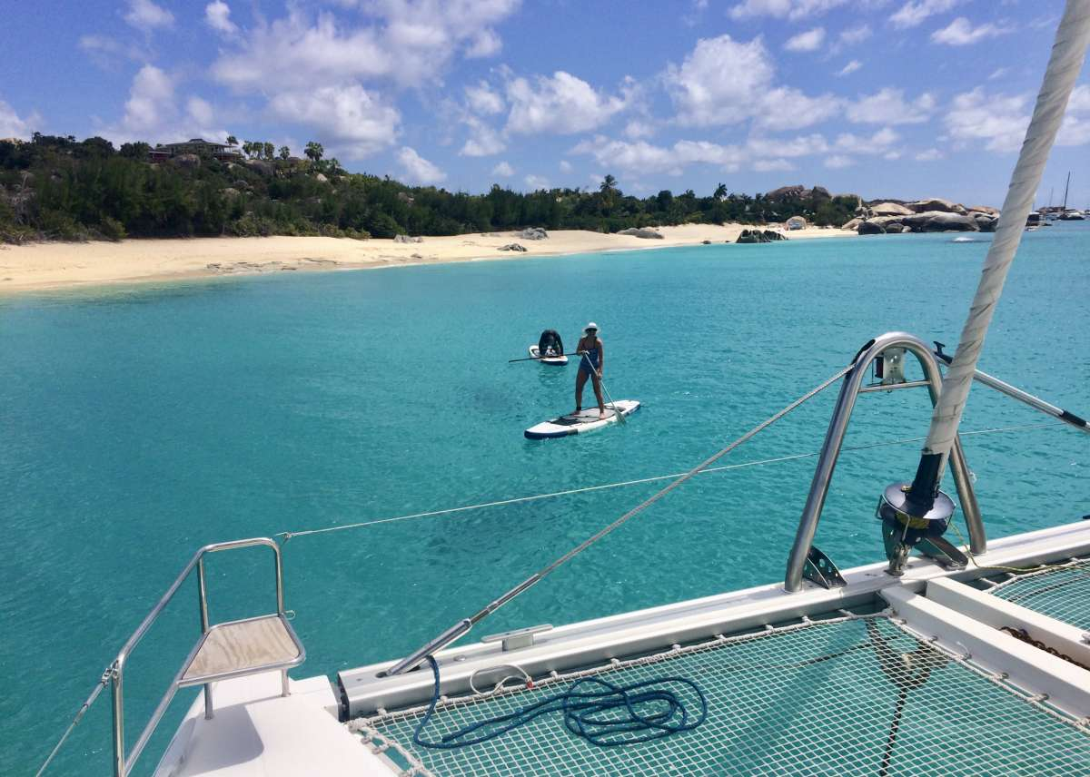 Fly bridge and helm seating for the whole party.  The shade Bimini has been lowered for everyone to enjoy the sunshine