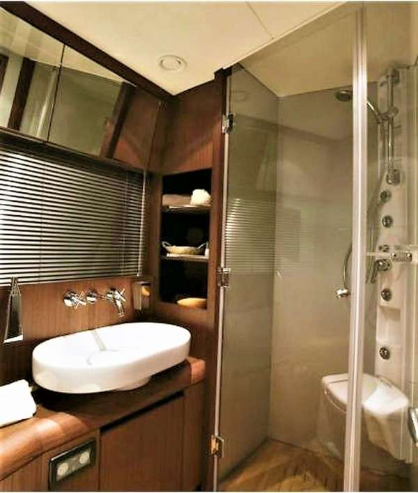 Twin cabin's en suite bathroom, with Hydro-Jet shower and 2 doors, used also as Day Head