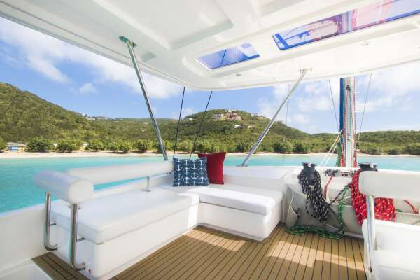 The flybridge has ample seating and provides a shaded, breezy area for happy hour.
