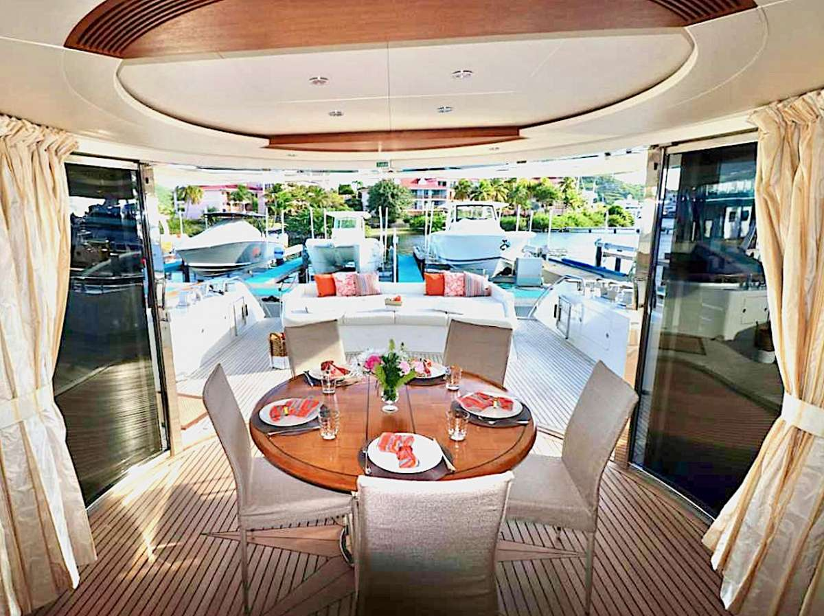 aft deck enclosure and lounge, table leaf can be added for large groups