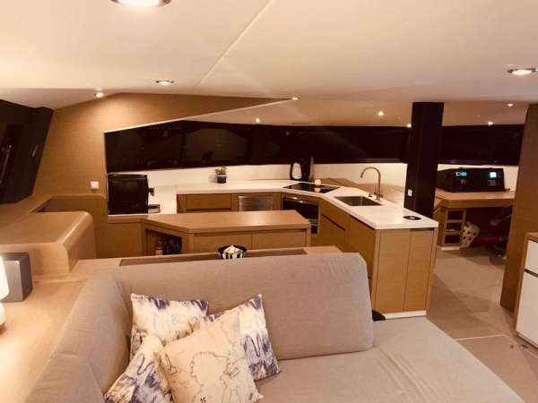 Contemporary, well equipped C-Shaped galley with a full bank of large glass windows that wrap the entire cabin.