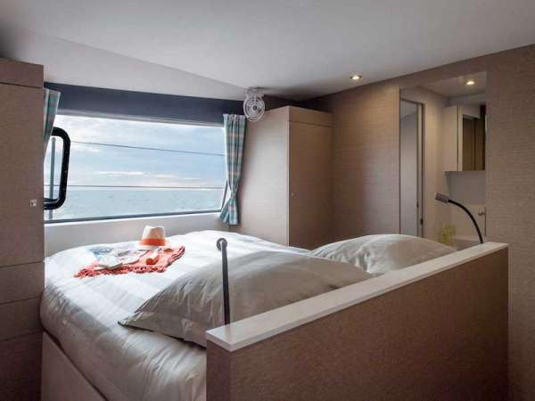 The Master Suite - what a place to relax and watch the world (or waves) go by through the large picture window.