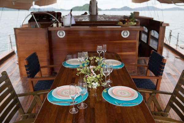Dining on aft deck under awning