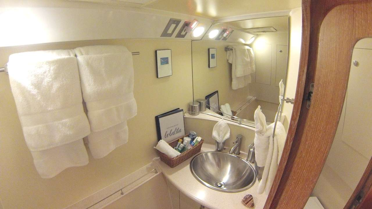 Lolalita master suite with spacious vanity and sink, and separate shower and head. Prepare to feel like royalty!