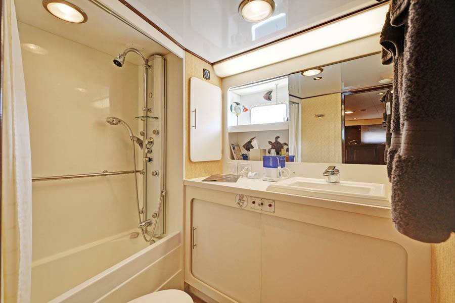 Ensuite Master Bathroom with shower and small bath tub.