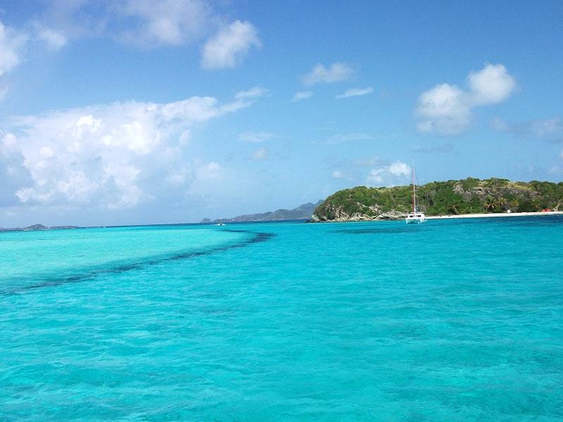 Crystal clear warm blue water