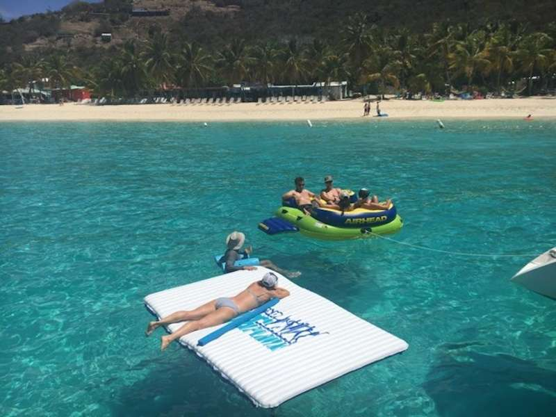 Guests relaxing on floating mats