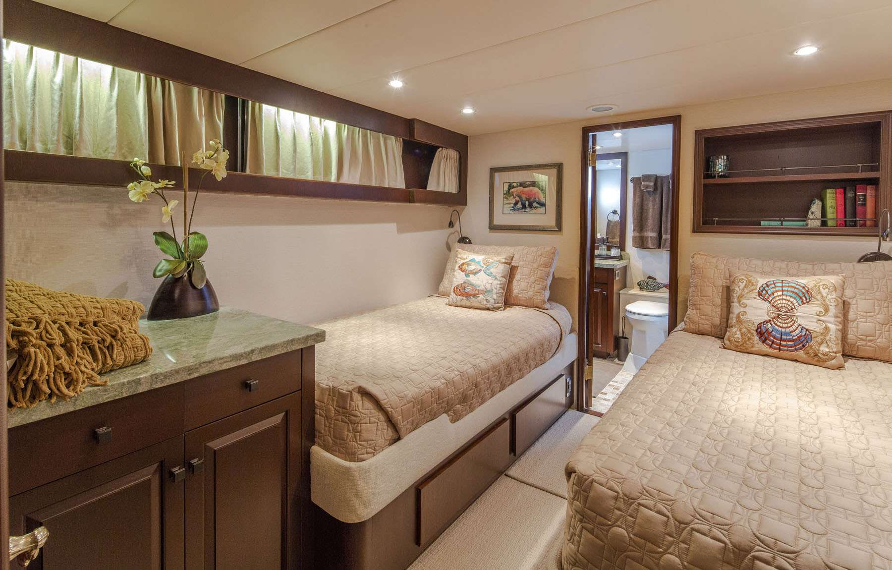 Port Twin Cabin with two single beds and ensuite bathroom.