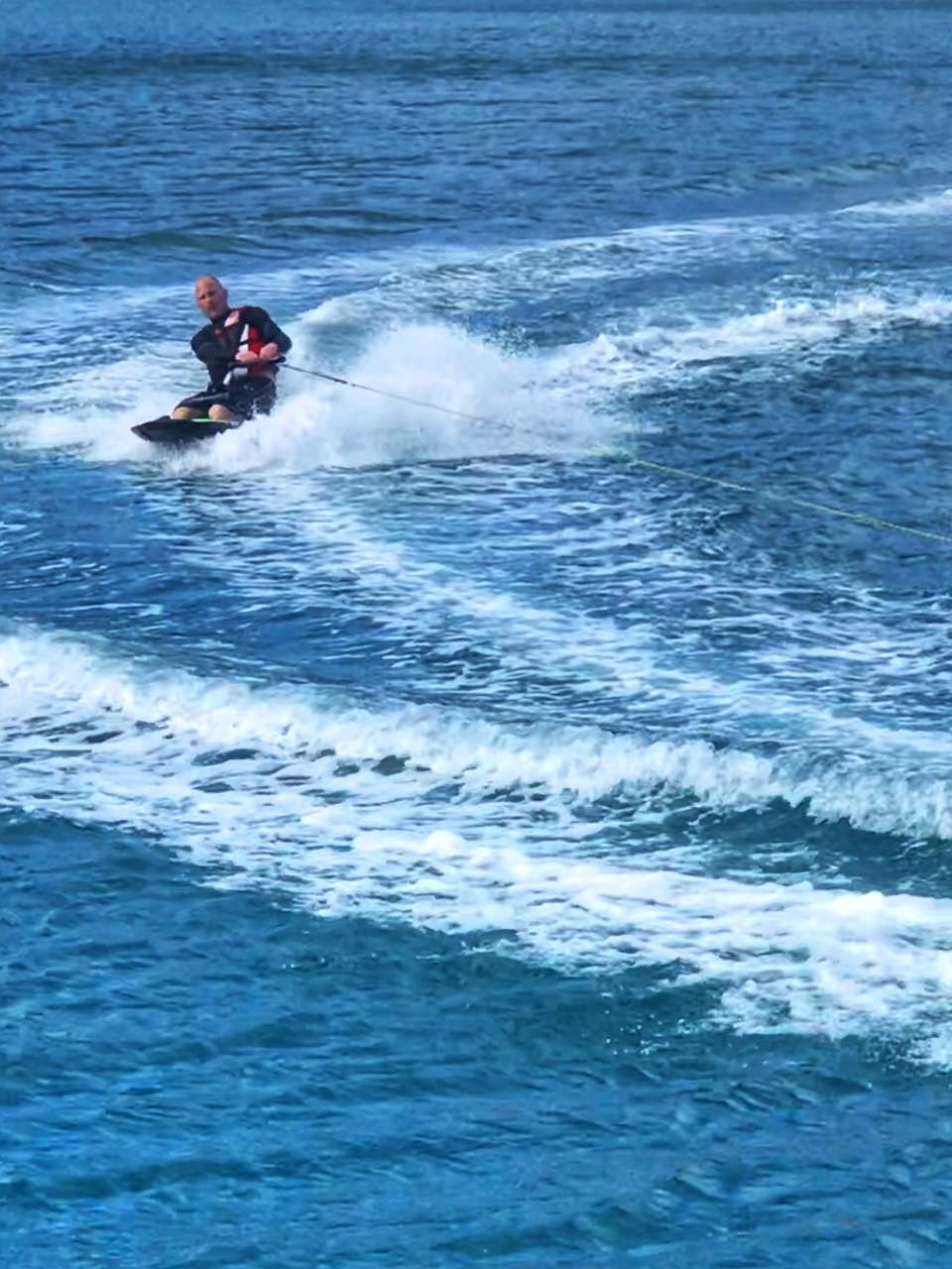 Kneeboarding! Even big kids get to have watersports fun!  We also have a big tube, wakeboard, and skis for the adventurous.