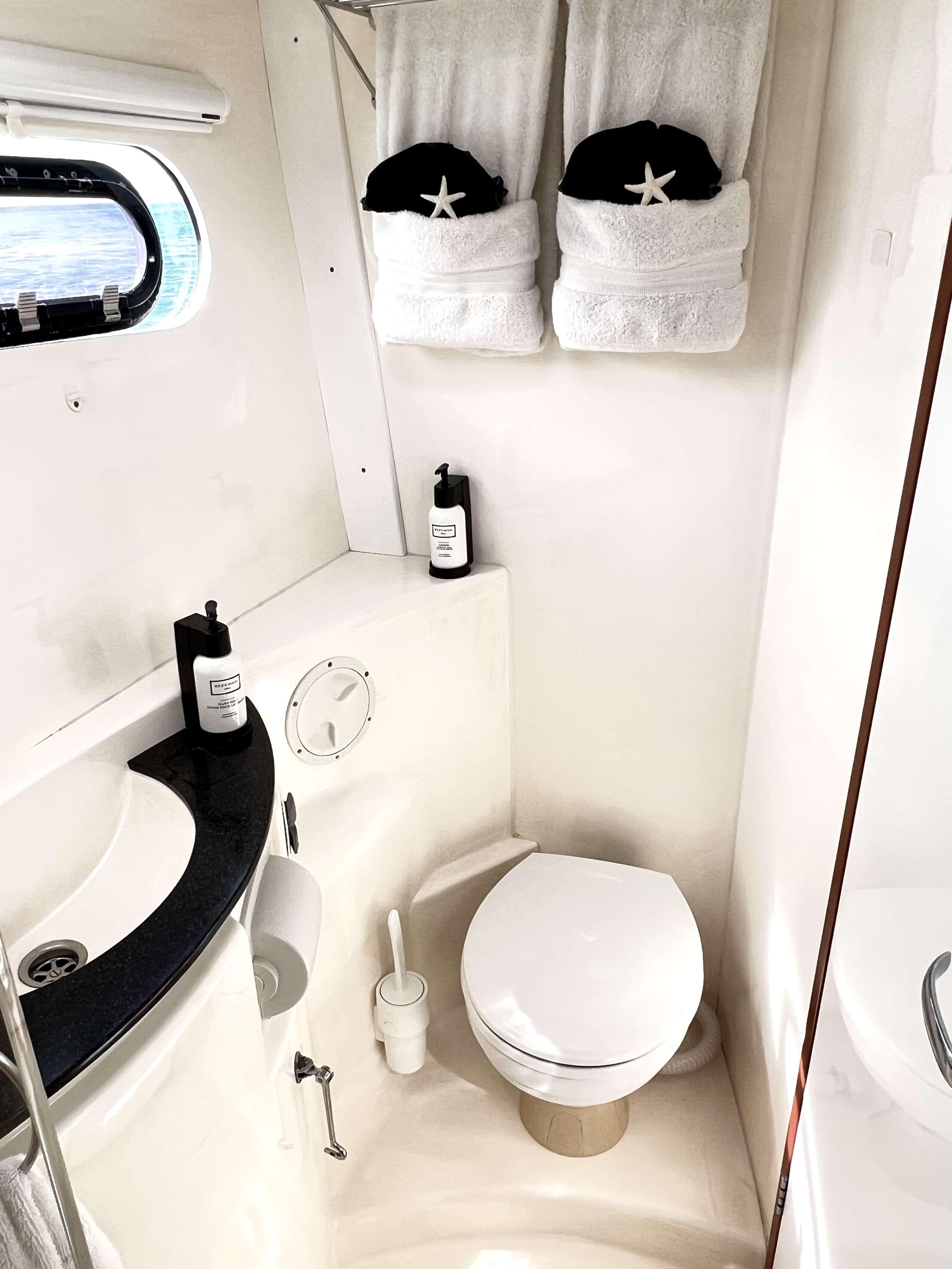 En suite Bathrooms/Showers in each cabin. (All bathrooms and showers are identical in all cabins.)