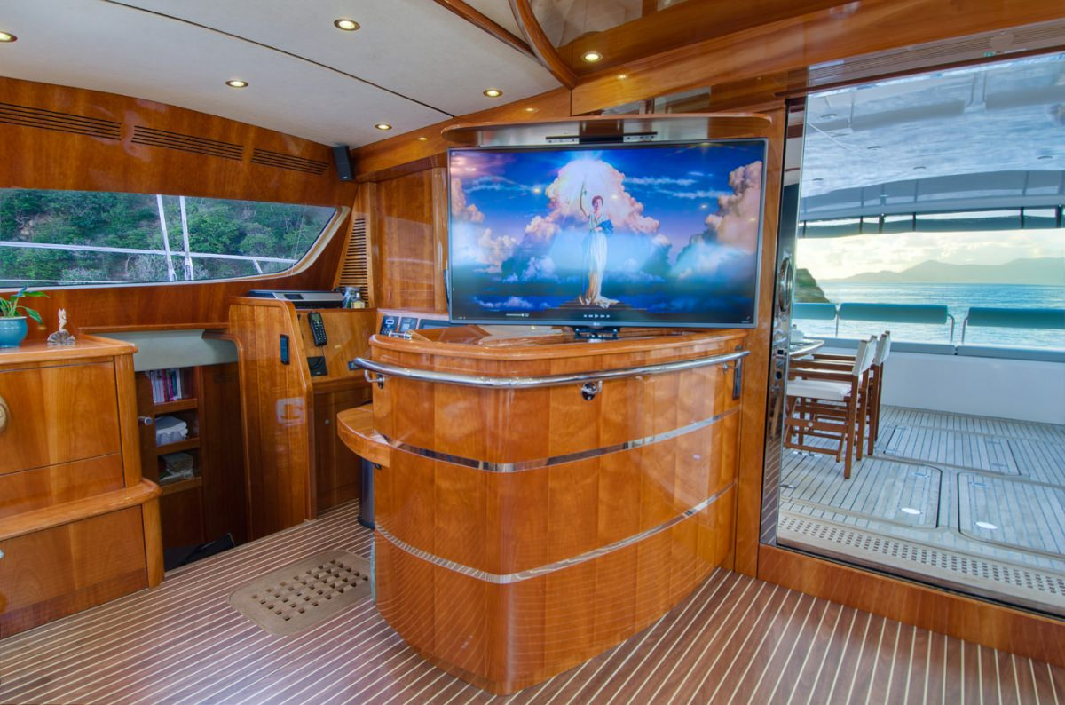 Bar, entertainment and view to deck