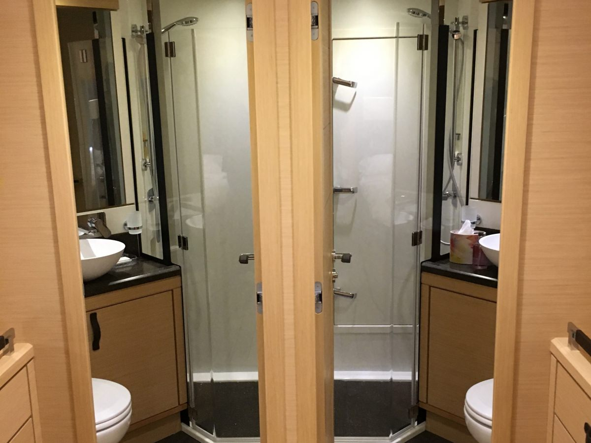 His & hers bathrooms in owners suite