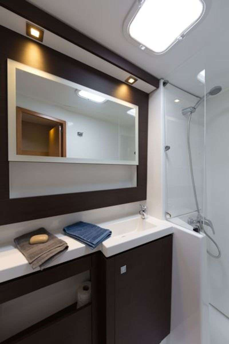 The master suite features a private bath with separate walk in shower.