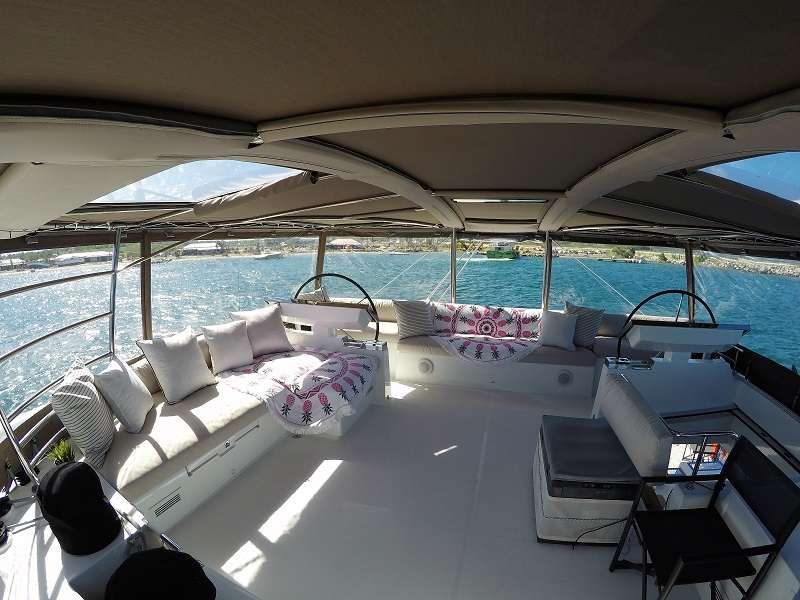 Flybridge and helm station. Chiller for cold beverages. The bimini offers drop down clear sides for protection from wind and rain if needed.