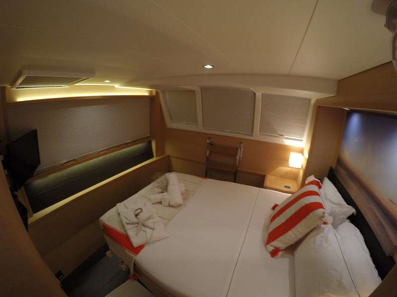 Queen size cabin with walk around bed.. Bed faces full size window.
