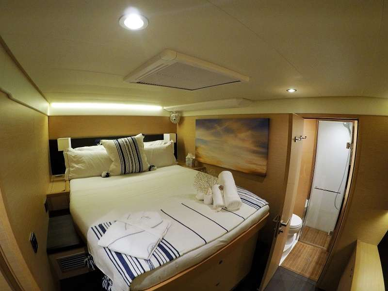 Queen size cabin with walk around bed.