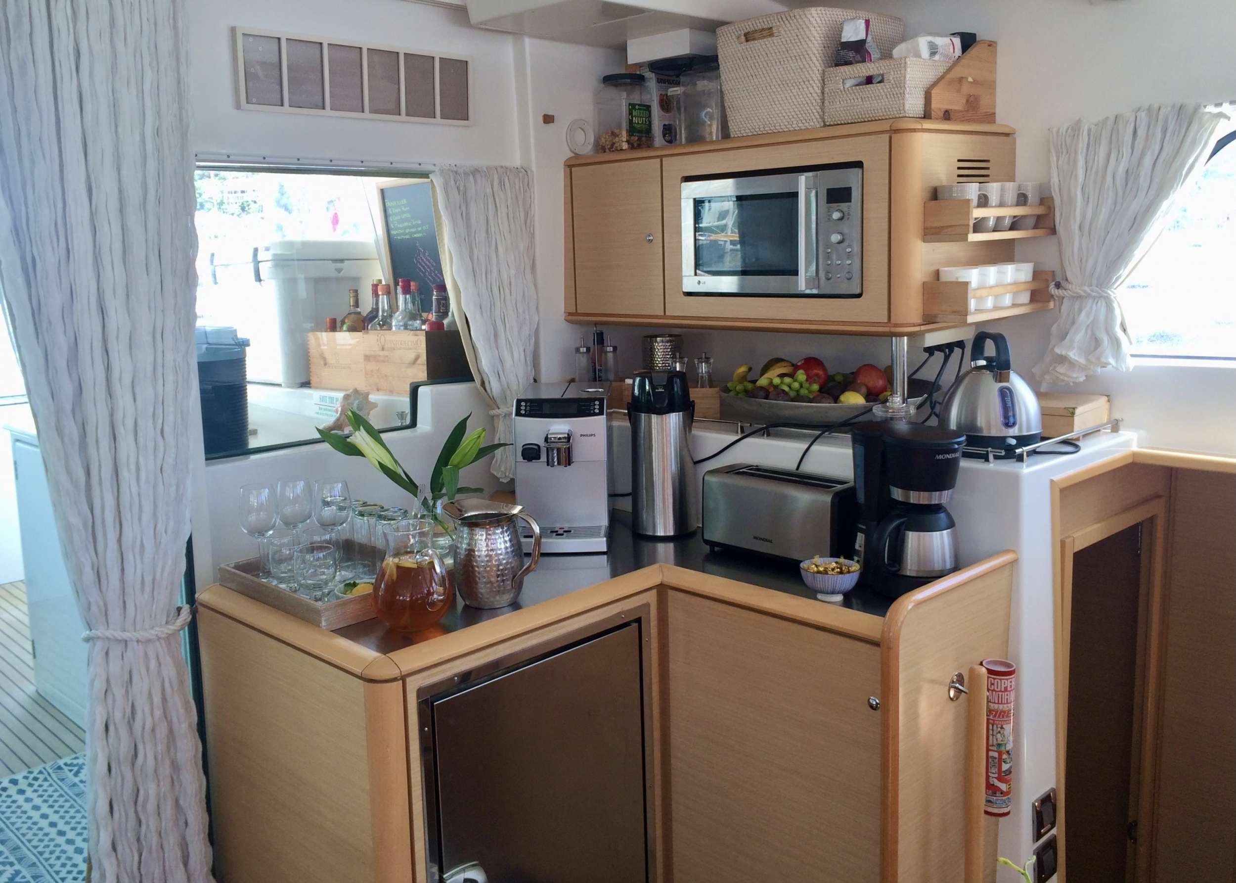 Coffee bar with modern coffee machine, and help yourself snack bar