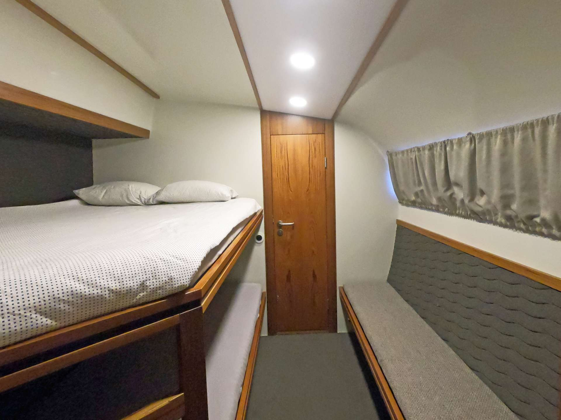 Double upper, single lower berths in all cabins
