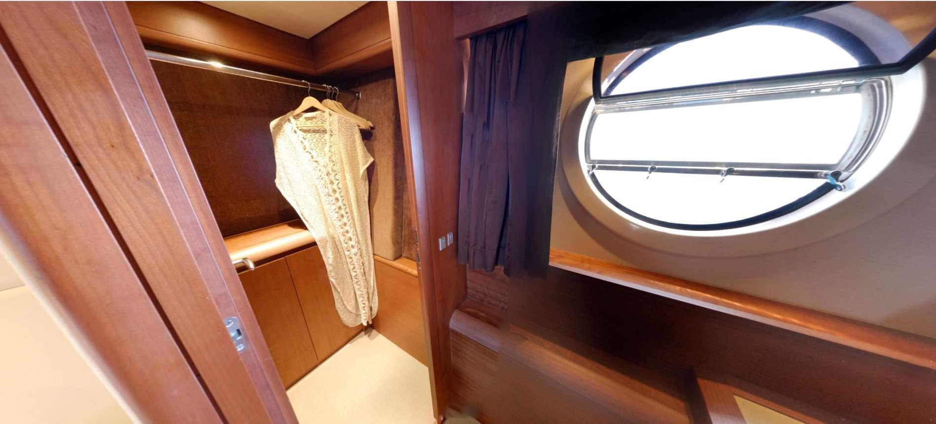 Master cabin has 2 large circular windows