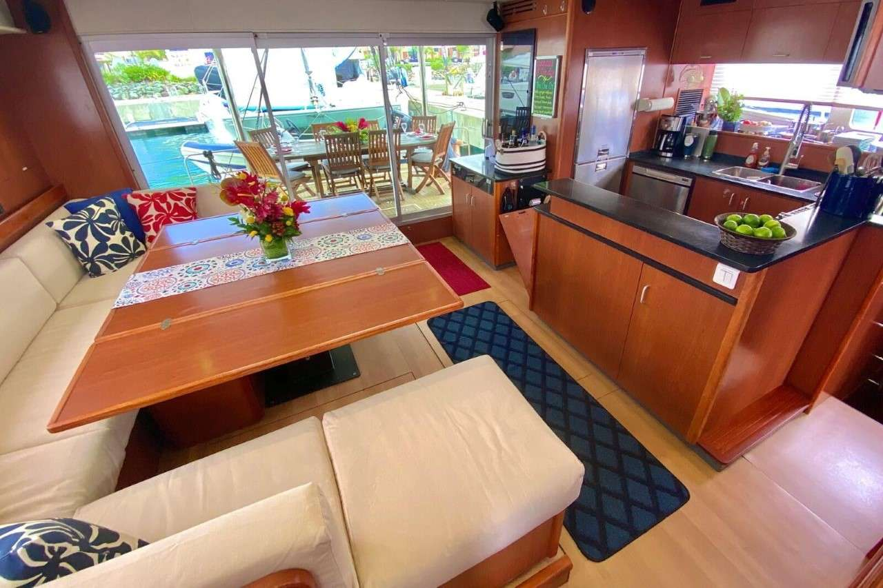 The open aft dining deck is just outside the galley/salon space.