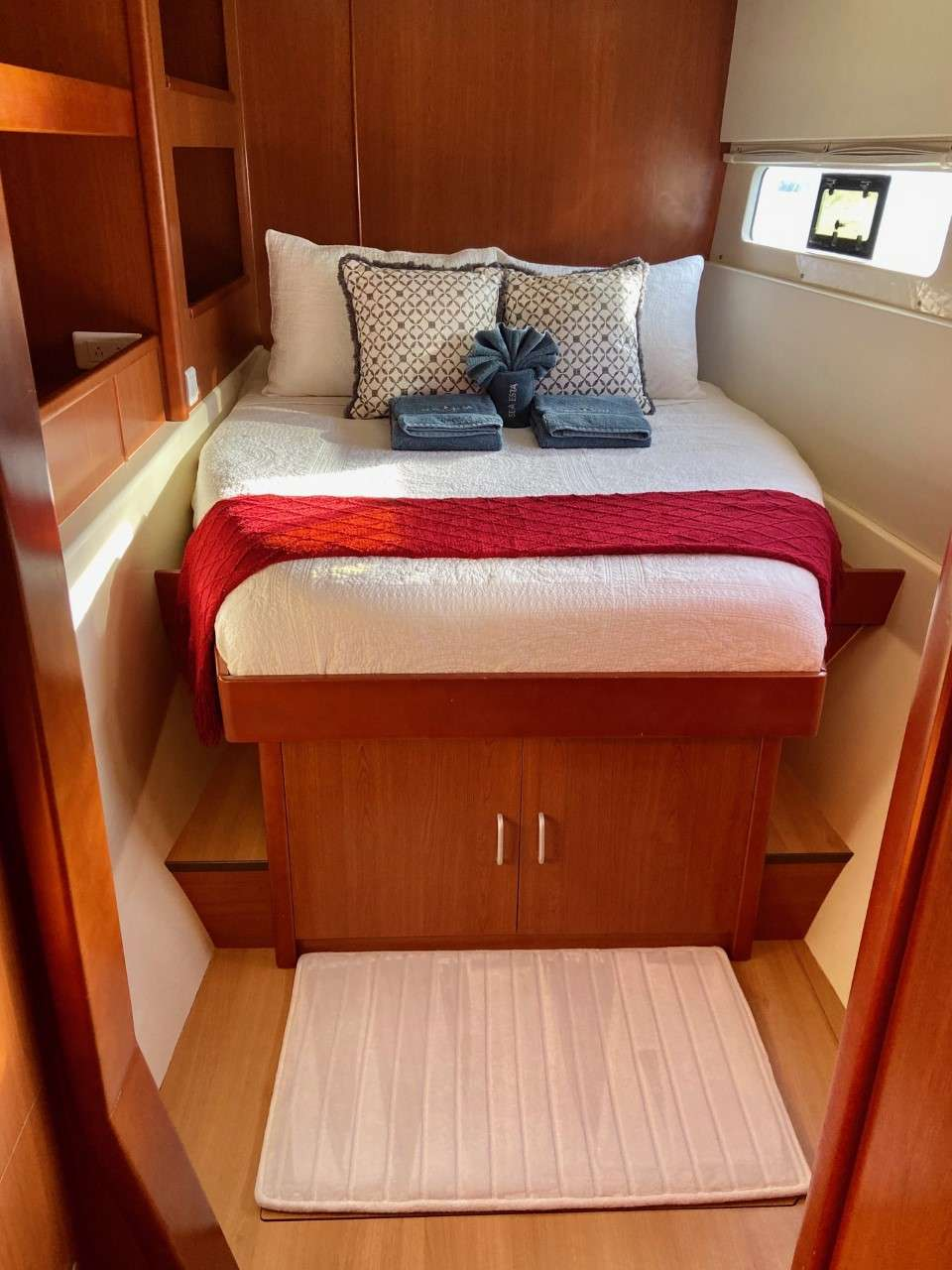 Lower level guest stateroom with opening hatch and port light for ocean breezes.