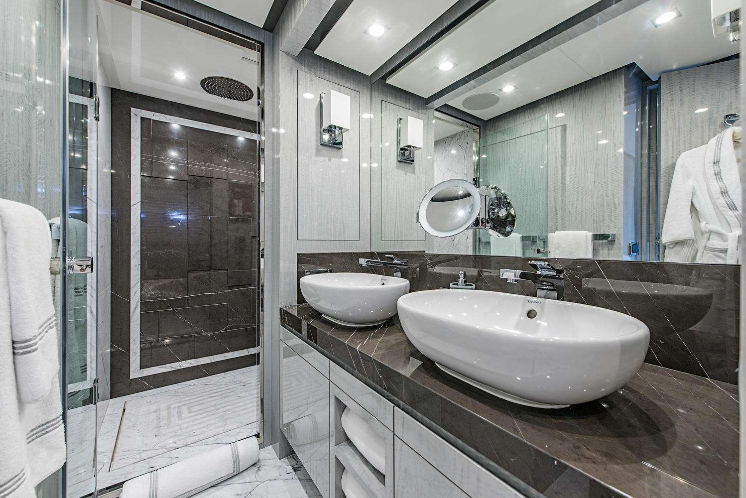 The en-suite master bathroom features Italian marble and rainforest shower with tasteful detailing and ample space.