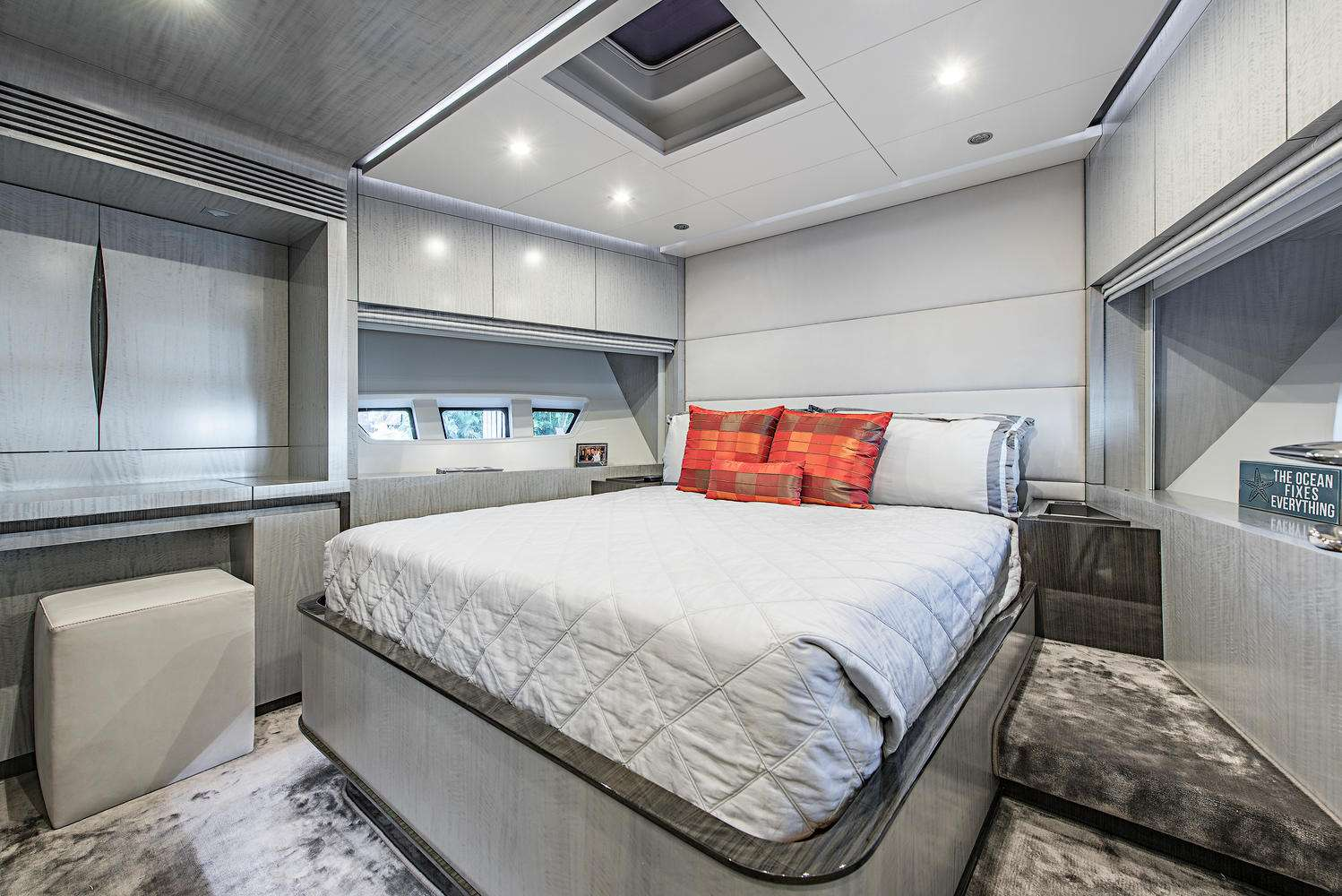 The VIP forward cabin features a queen bed, plenty of storage space and plush soft goods and carpeting.