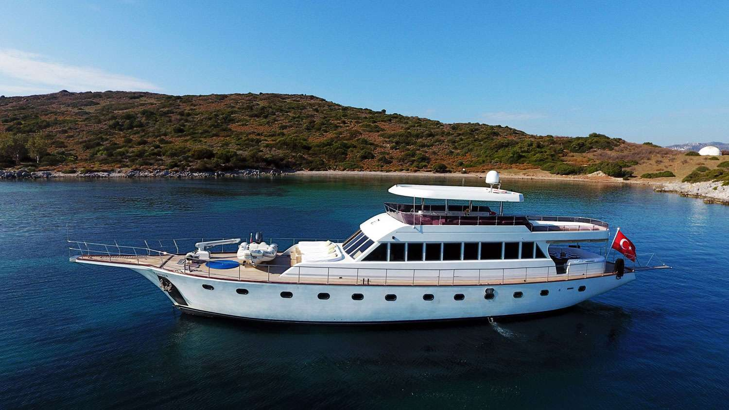 Refitted in 2014, CANEREN offers an abundance of both interior and exterior space for guests thanks to her large motor yacht style saloon and extended flybridge. There is capacity to accommodate up to 9 passengers in 4 guest cabins which include 3 very comfortable double cabins and a pullman triple cabin. She is an ideal choice for 3 couples looking for a yacht with equal size accommodation for each couple. Though CANEREN can accommodate up to 9 guests, she is restricted to a maximum carrying capacity of eight on international voyages. The flexibility to offer fine dining on the aft deck as well as the flybridge means guests on board have access to pleasant change of scenery as they please. Lazy days on the Med are what is awaiting guests on board CANEREN but with plenty of water toys on board and a crew of 4 to make sure everything is catered for means you can always have action whenever you want.