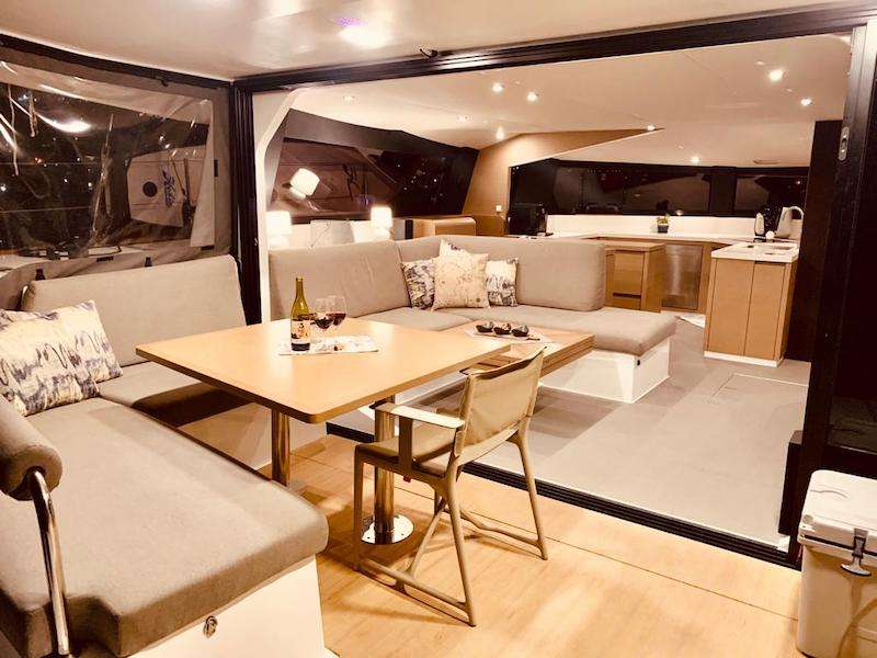 A wonderful cockpit/saloon area that brings the two together in massive outdoor living thanks to the glass sliding doors.