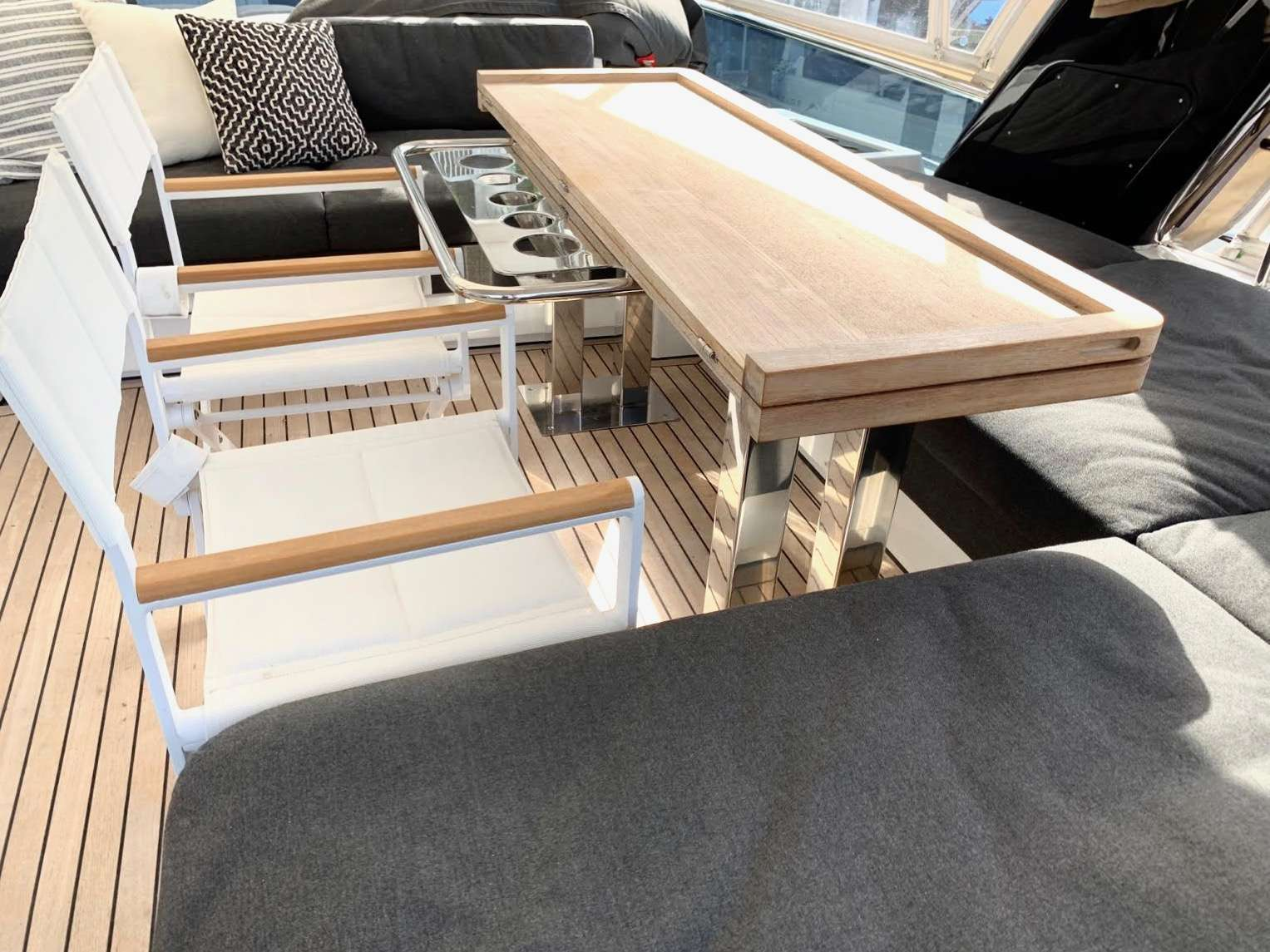 Two cozy trampolines and lounge cushions at the bow