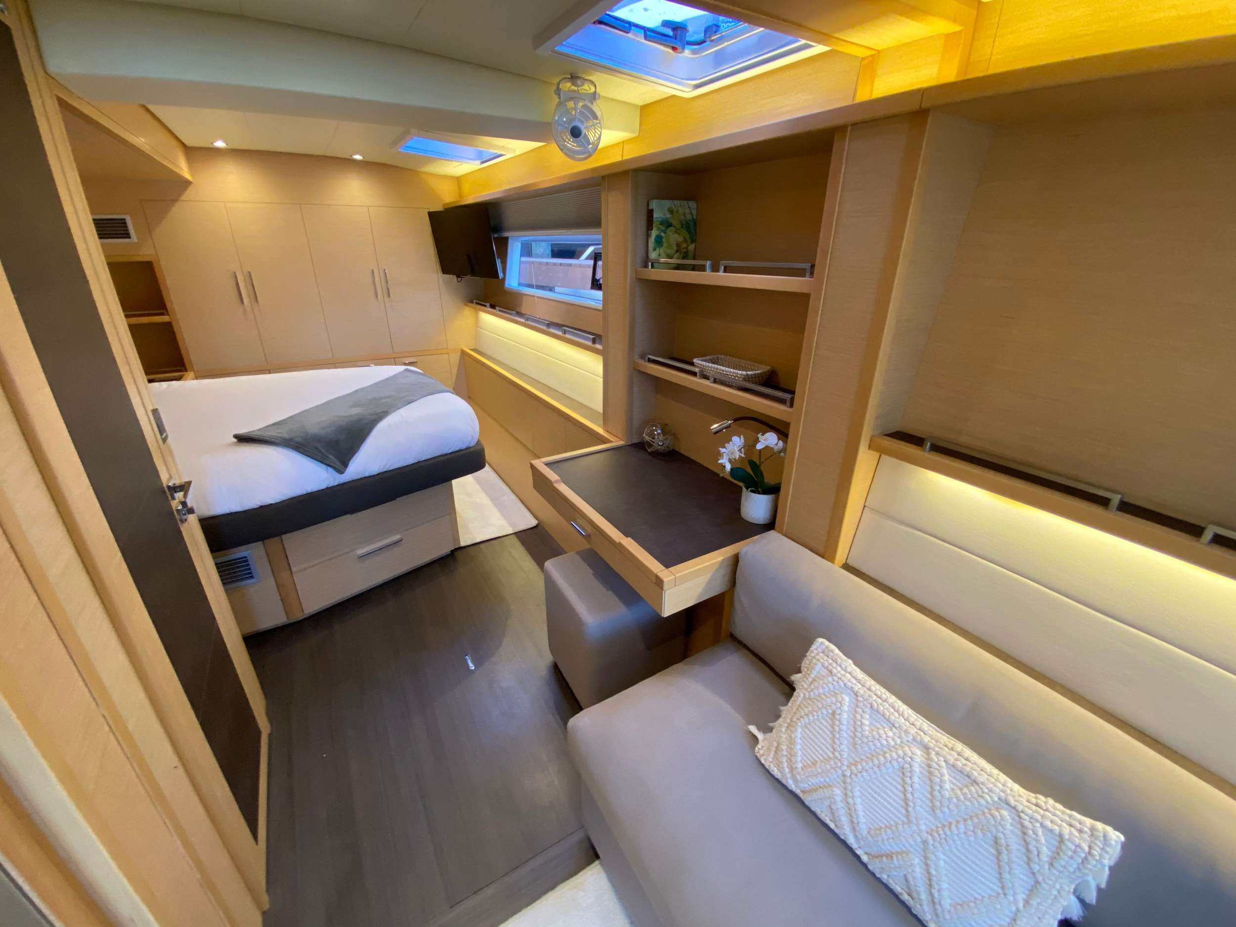 Primary cabin with Queen berth, vanity and settee